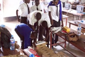 Students unpacking computers at Mekomariro